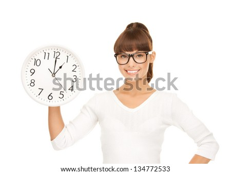 picture of attractive businesswoman with wall clock
