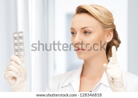 picture of attractive female doctor with pills - stock photo