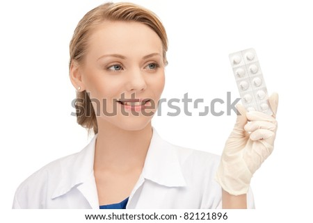 picture of attractive female doctor with pills