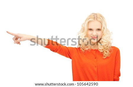 picture of attractive student pointing her finger - stock photo