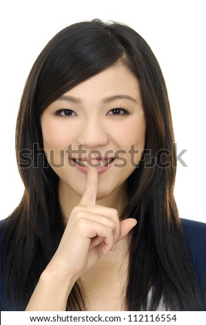 picture of attractive young woman pointing her finger - stock photo