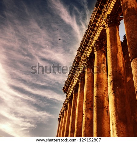 Picture of Baalbek Heliopolis ruins, ancient Lebanon landmark over dark sky, arabian architecture, antique religions building, famous jupiter monument, columns statue, travel and tourism concept