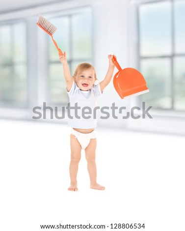picture of baby boy with with dustpan and brush - stock photo
