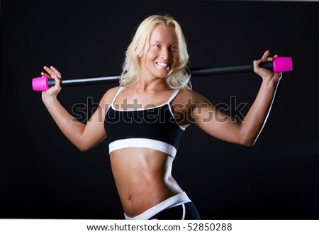 Picture of beautiful  athlete in fitness room - stock photo