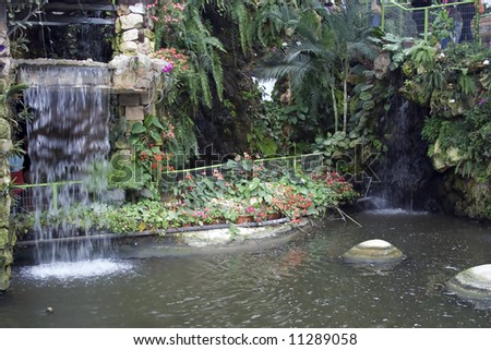 Picture of beautiful botanic garden with small waterfall - stock photo