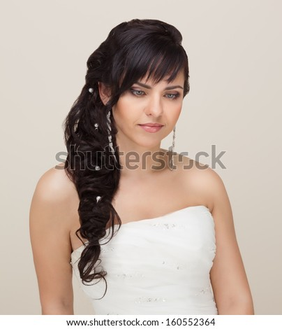 Picture of beautiful bride with make-up and hairstyle