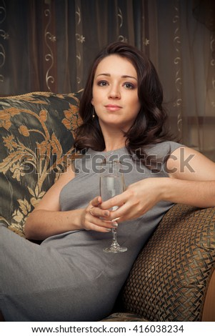 Picture of beautiful brunette woman with glass of wine - stock photo