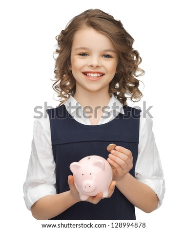picture of beautiful girl with piggy bank - stock photo