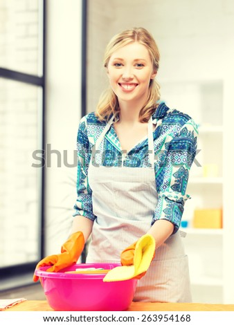 picture of beautiful housewife washing dish at the kitchen .. - stock photo