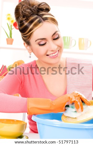picture of beautiful housewife washing dish at the kitchen - stock photo