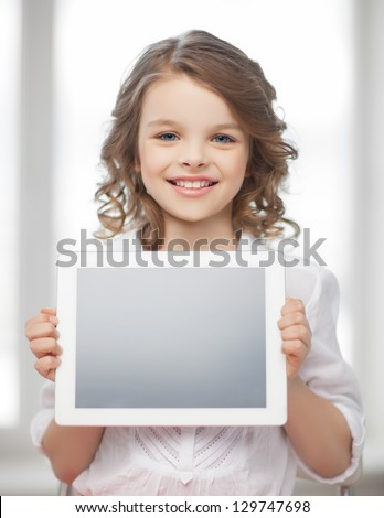 picture of beautiful pre-teen girl with tablet pc - stock photo