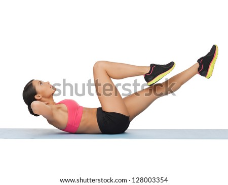 picture of beautiful sporty woman doing exercise - stock photo