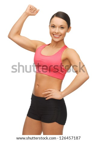 picture of beautiful sporty woman flexing her biceps