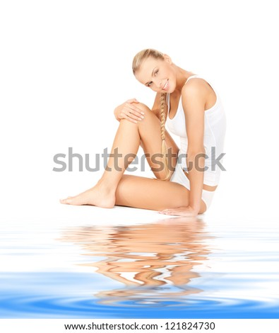 picture of beautiful woman in cotton undrewear on white sand - stock photo
