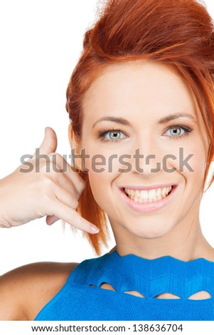 picture of beautiful woman making a call me gesture.... - stock photo