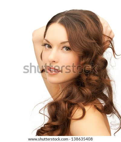 picture of beautiful woman playing with long hair - stock photo