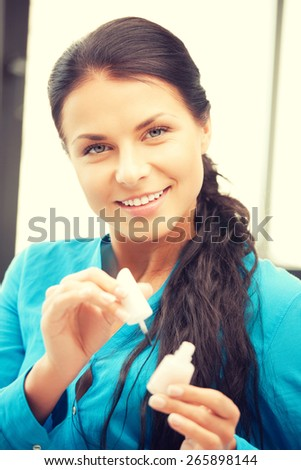 picture of beautiful woman polishing her nails - stock photo