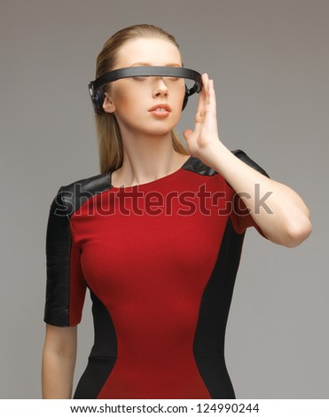 picture of beautiful woman with futuristic glasses - stock photo
