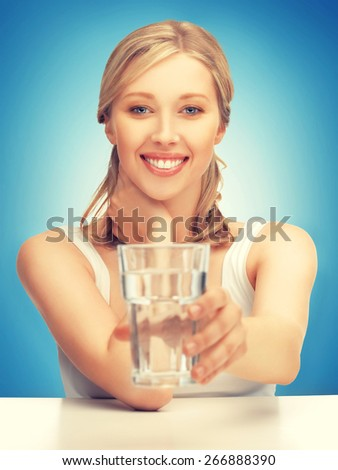 picture of beautiful woman with glass of water . - stock photo