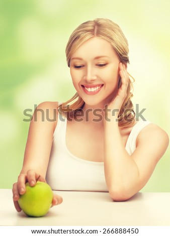 picture of beautiful woman with green apple - stock photo
