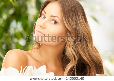 picture of beautiful woman with madonna lily flower - stock photo