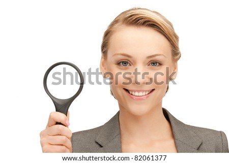 picture of beautiful woman with magnifying glass - stock photo