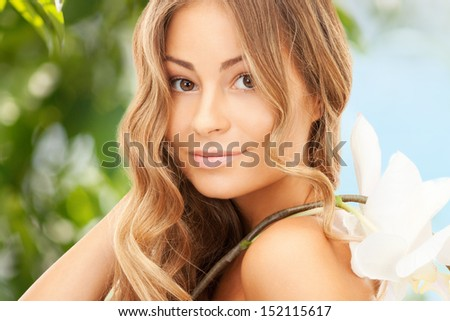 picture of beautiful woman with orchid flower