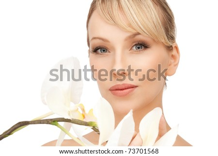 picture of beautiful woman with orchid flower - stock photo