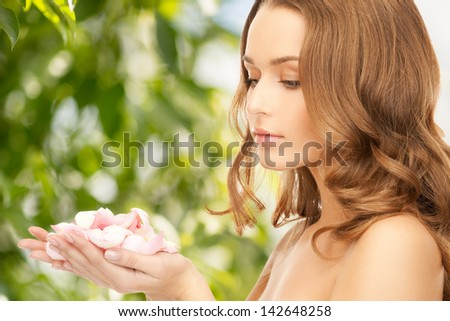 picture of beautiful woman with rose petals - stock photo