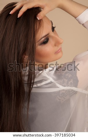Picture of beautiful woman with smoky-eyes make-up looking back - stock photo