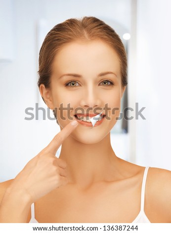 picture of beautiful woman with white teeth - stock photo