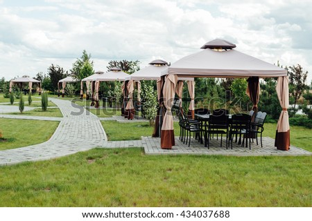 Picture of beauty garden with modern gazebo. - stock photo