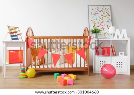 Picture of bright newborn room interior with colorful toys - stock photo