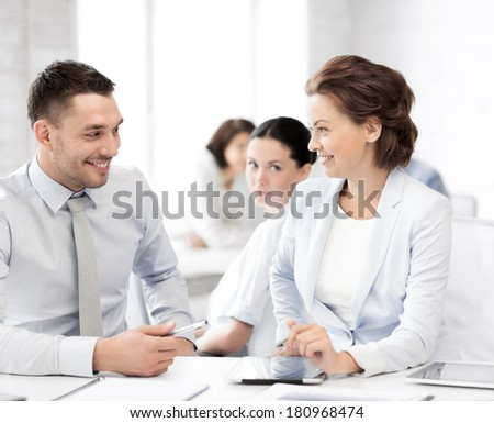 picture of business colleagues talking in office