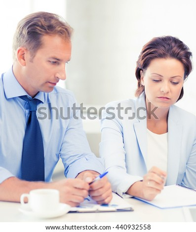 picture of business team discussing something in office