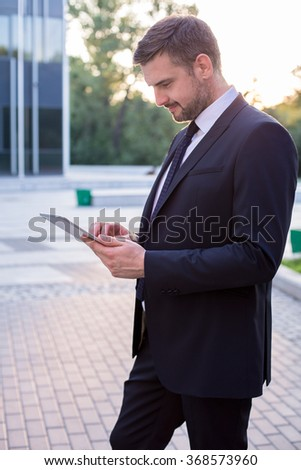 Picture of businessman working with tablet in the city