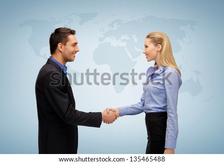 picture of businesswoman and businessman shaking hands - stock photo