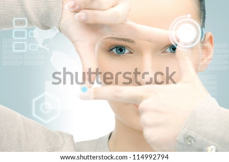picture of businesswoman creating frame with fingers - stock photo