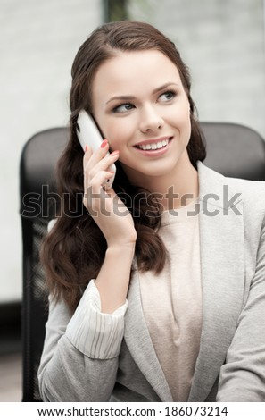 picture of businesswoman with cell phone calling or talking - stock photo