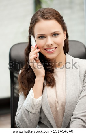 picture of businesswoman with cell phone callling or talking - stock photo