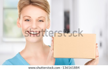 picture of businesswoman with parcel in office - stock photo