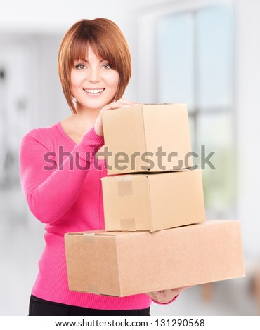 picture of businesswoman with parcels in office - stock photo