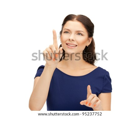 picture of businesswoman working with something imaginary