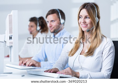 Picture of call center consultant with computer during work