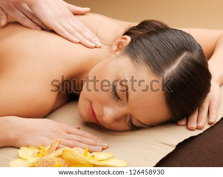 picture of calm beautiful woman in massage salon - stock photo