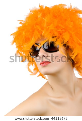 picture of carnival woman with orange feather wig and sunglasses over white background - stock photo