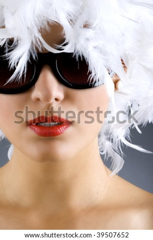 picture of carnival woman with white feather wig and sunglasses over white background - stock photo