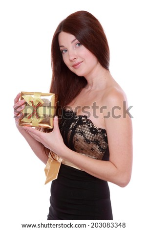 picture of cheerful girl in black and gold dress with gift boxis - stock photo