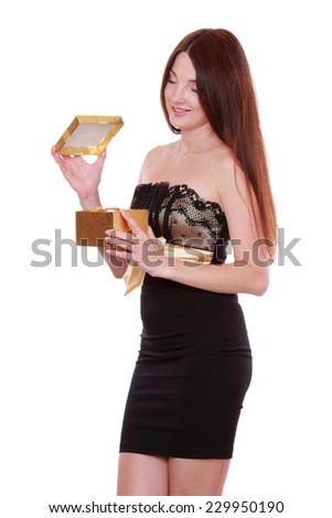 picture of cheerful girl in black and gold dress with gift boxisolated over white background on Holiday theme/ - stock photo