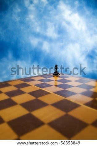 Picture of chess pawn on a chessboard - stock photo